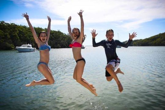 The-kids-had-a-ball-at-Fame-Cove,-jumping-off-the-boat,-swimming-and-paddling-around